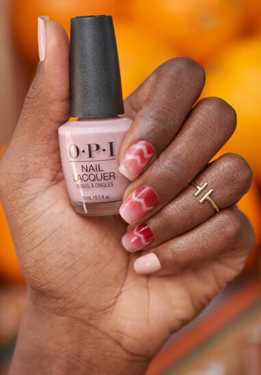 opi-small-asset-nail-laquer-hand-swatch-holding-pink-nail-coloured-bottle